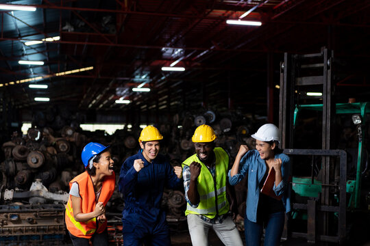 Group of diversity factory employee worker successful about work at the industry factory old garage automotive spare parts warehouse
