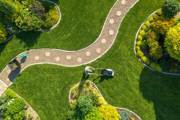Big Garden Grass Field Mowing by Caucasian Gardener - fototapety na wymiar