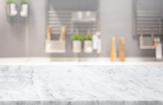 Selective focus,Marble table top on blur white kitchen room background.F