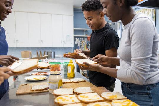 Volunteers making sandwiches in community center kitchen