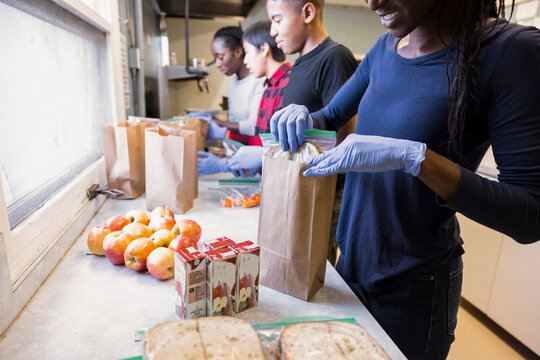 Volunteers packing lunches in community center kitchen
