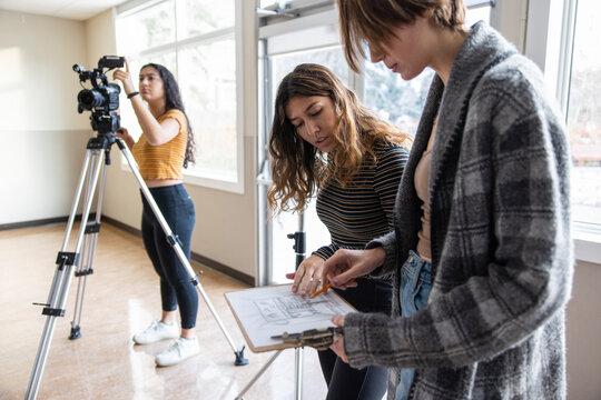High school girl drama students preparing for show in studio