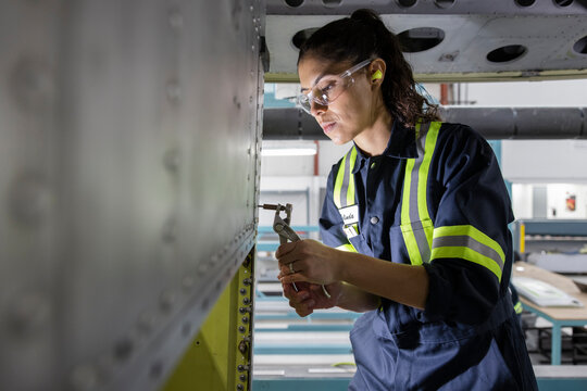 Technician working on helicopter interior