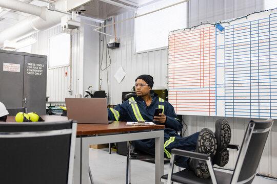 Technician using laptop in meeting room