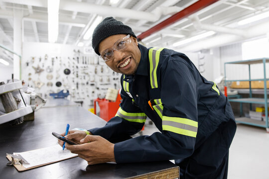 Technician checking list with phone