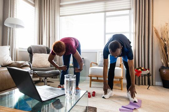 Senior couple exercising at home