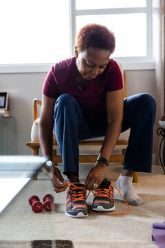 Senior woman preparing to exercise at home