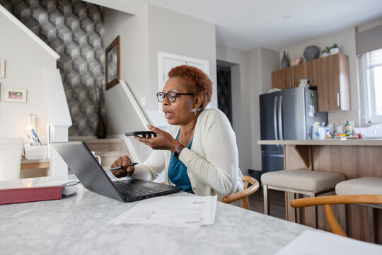Senior woman using digital devices at home