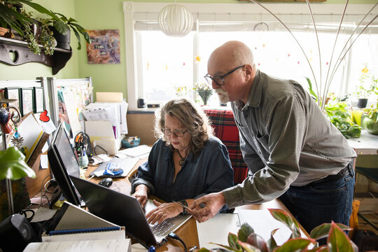 Senior couple shopping online with laptop