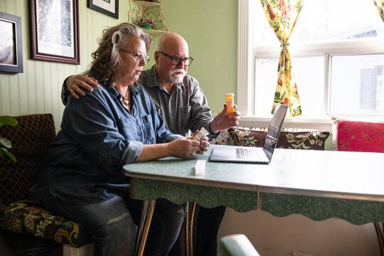 Senior couple seeking medical advice on video call