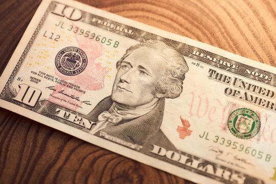Ten U.S. American dollars on a wooden background