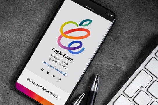 Antalya, Turkey - April 13, 2021: hands holding iPhone with Apple event logo 2021 on the screen.