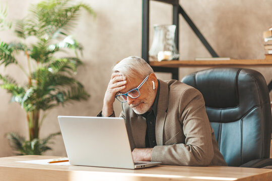 The manager is desperate. A grown-up gray-haired man took hold of his head in the office in front of a laptop. Burnout and business failure. Bankruptcy or dismissal.
