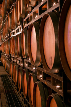 Wall of wooden wine barrels stacked over each other