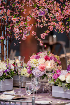 Indoor dinner setting for a wedding ceremony event with flowers and candles