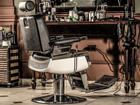 Stylish vintage barber chair. Professional hairstylist in barbershop interior. Barber shop chair. Barbershop armchair, modern hairdresser and hair salon, barber shop for men
