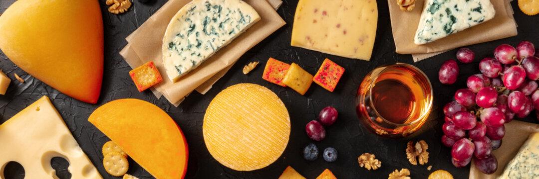 Cheese, wine, and fruit panorama, top shot