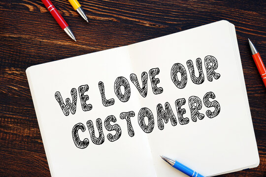Business concept meaning We Love Our Customers with phrase on the sheet.