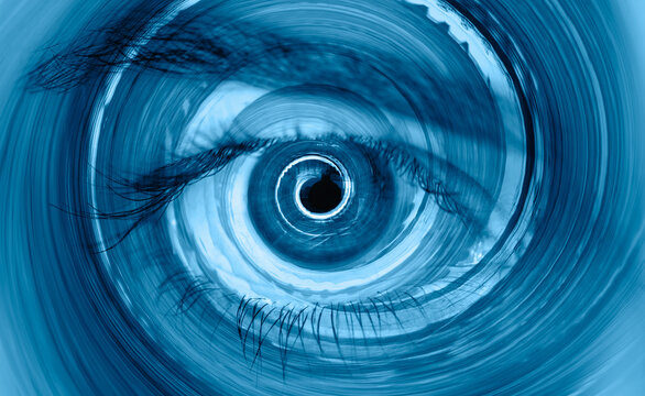 Hypnosis Spiral in eye with vertigo   -  Image of abstract spiral hazel eye