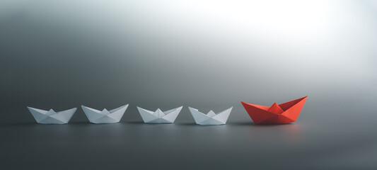 Fototapeta success leadership concept, blue leader boat leading white, strategy planning development