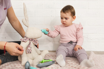 Obraz little girl plays with her mom as doctor. family and free time at home concept. - fototapety do salonu