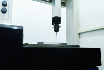 Fototapeta Operator inspection dimension metal parts by CMM after machining process in industrial