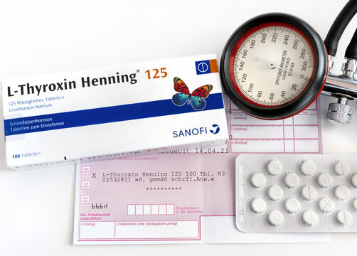 Box of L-thyroxin Henning thyroid hormone, prescription, tablets and blood pressure monitor, Close up.