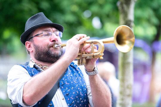 Man Playing Trumpet Outdoors