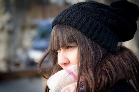 Close-up Of Woman In Knit Hat Looking Away