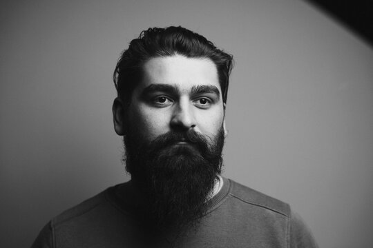 Young Man With Beards Against Wall