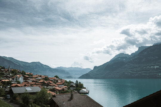 Scenic View Of Buildings By Lake Against Sky