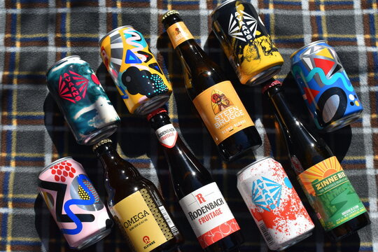 Belgian beers in London, UK on April 4 2021 are ales opposed to lagers with fruity yeast flavours malts. They are spontaneously fermented the wort is open to air allowing local yeasts and bacterias in