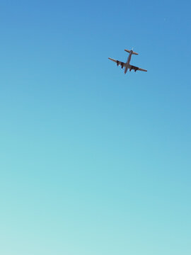 World War Ii Airplane Flying Above Wright Brothers National Memorial
