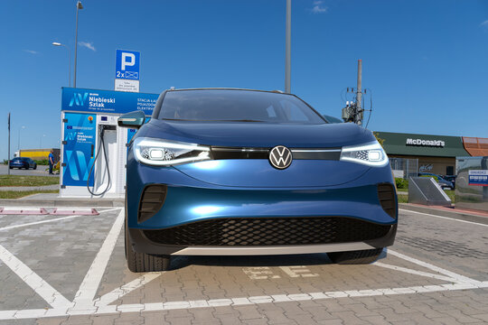 Volkswagen ID.4, Electric SUV standing at the charging station belonging to the Lotos concern