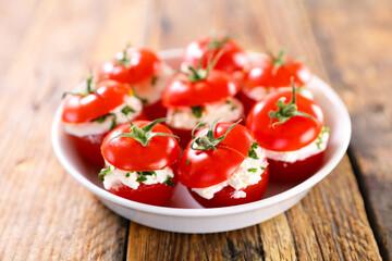 cherry tomato garnish with cream cheese and herbs