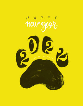 Tiger footprint with New Year numbers 2022. Happy New Year greeting card. 2022 is the year of the yellow tiger in the chinese calendar. Hand drawn paw footprint. Vector illustration.