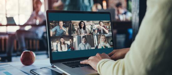 Fototapeta Video call with startup team at loft office obraz
