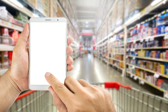 Human using Mobile Phone with white screen on Department store blurred background