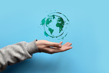 Fototapeta Drawing of the planet Earth in the hand of a person. Protecting and caring for planet Earth obraz