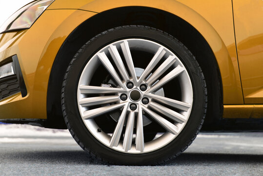 Tire and alloy wheel on this passenger car
