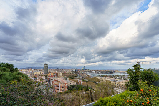 Barcelona, Spain. March 2021: Cityscape top view on Barcelona city from Miramar gardens in Spain