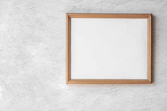 A3, A4 horizontal blank picture frame mockup template for photographs hanging white gray concrete wall background