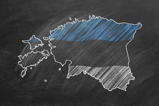 Country map and flag of Estonia drawing with chalk on a blackboard. One of a large series of maps and flags of different countries. Education, travel, study abroad concept.