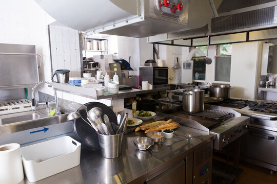 View of empty restaurant kitchen with professional equipment and products..