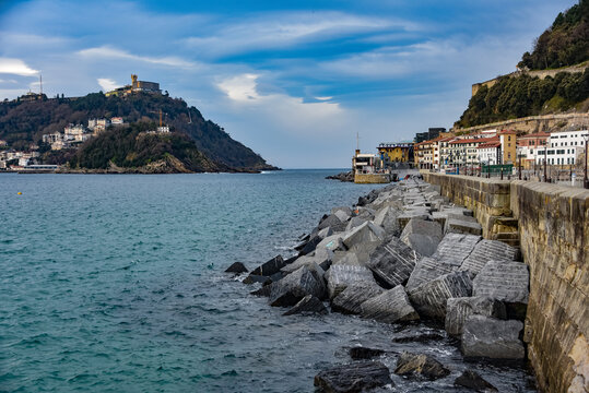 San Sebastian, Spain - April 2, 2021:  Harbour walls and views across La Concha bay from old town San Sebastian