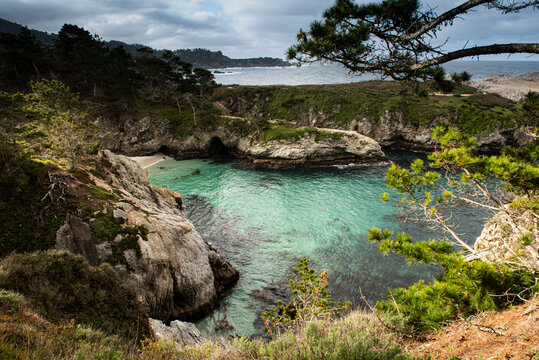 Point Lobos State Park, China Cove, intense aqua, on a partly cloudy day