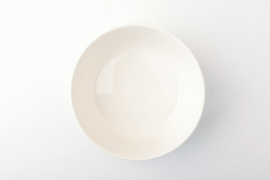 Porcelain bowl on a white background