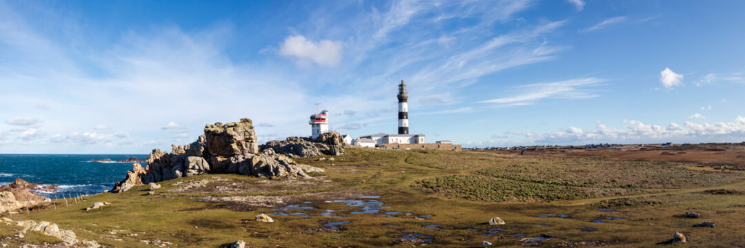 Lighthouse and Beacon of Ouessant, the island of Ushant, in Brittany, french rocky beach in northern France, Finistere