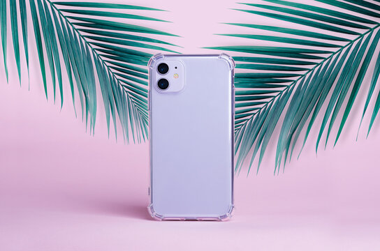 Purple iPhone 11 isolated on a pink background with palm leaves, clear phone case mockup, iPhone 12 mock up