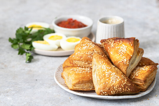 Mediterranean breakfast - burek with cheese, eggs, sauce and coffee.